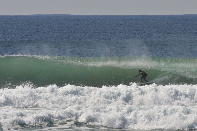 This guy shreds, surfed so fast, he actually made this one and got pitted again.