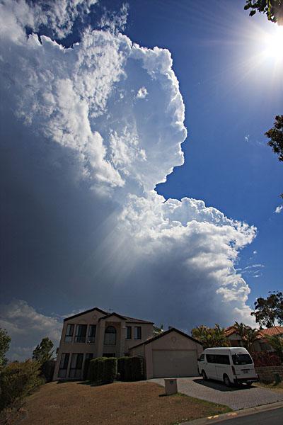 Looming over the neighborhood.