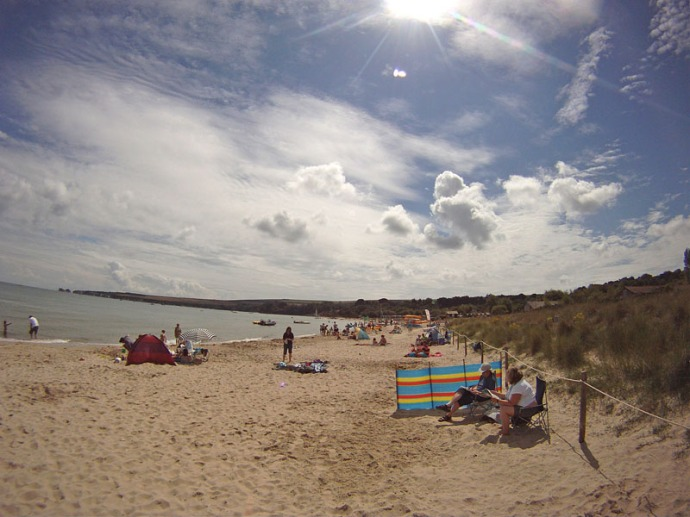 The sun beams down on Studland Beach