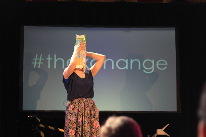A lady with a cereal box on her head