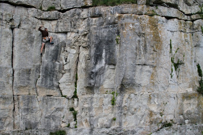 A climber on a large rock face