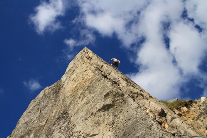 An image of a climber on a rock