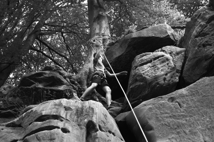 An image of a climber on a rope at Harrison's Rocks.