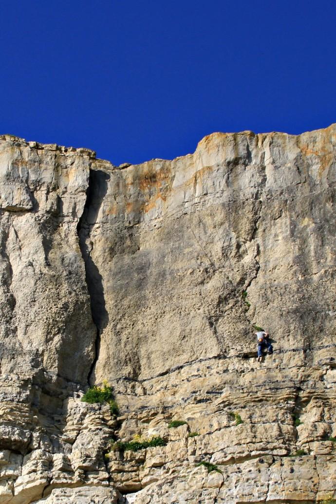 A climber at Portland, Dorset, sport climbing at Blacknor